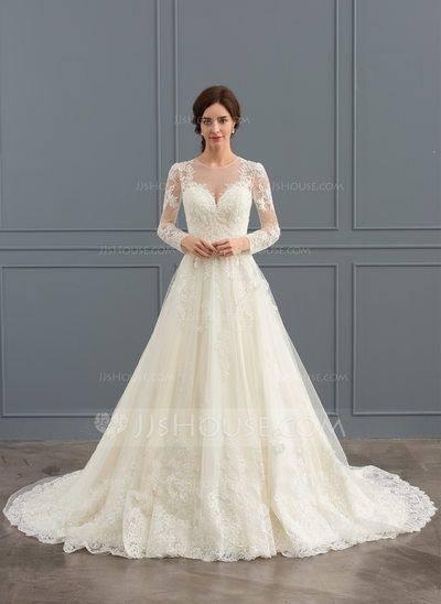 Brunette model shows off strapless modern wedding gown