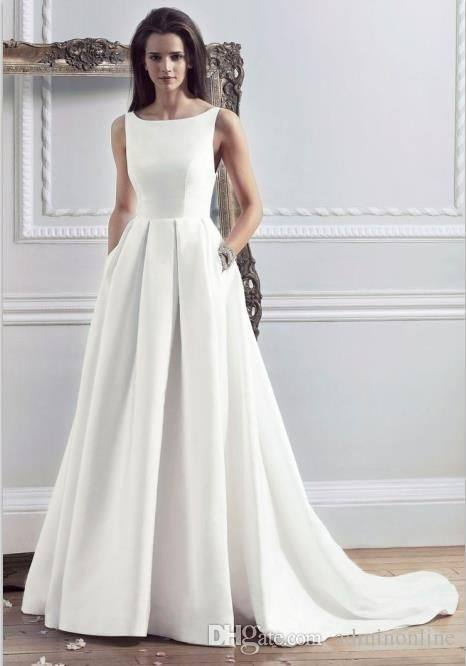 an illusion lace applique bodice with long sleeves and a plain skirt with  pockets