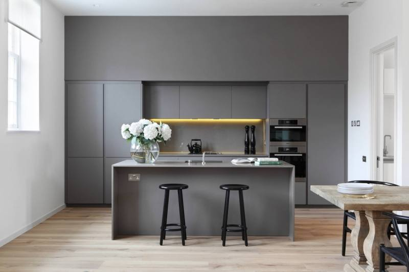 Pair gray cabinets with warm colors and materials