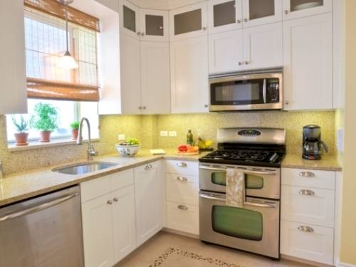 Adorable Modern Small Quaint Kitchen Ideas Showing Dark Brown Wooden Dining Bench On Light Brown Laminate Wood Floor Plus Yellow Kitchen Cabinet Over Cone