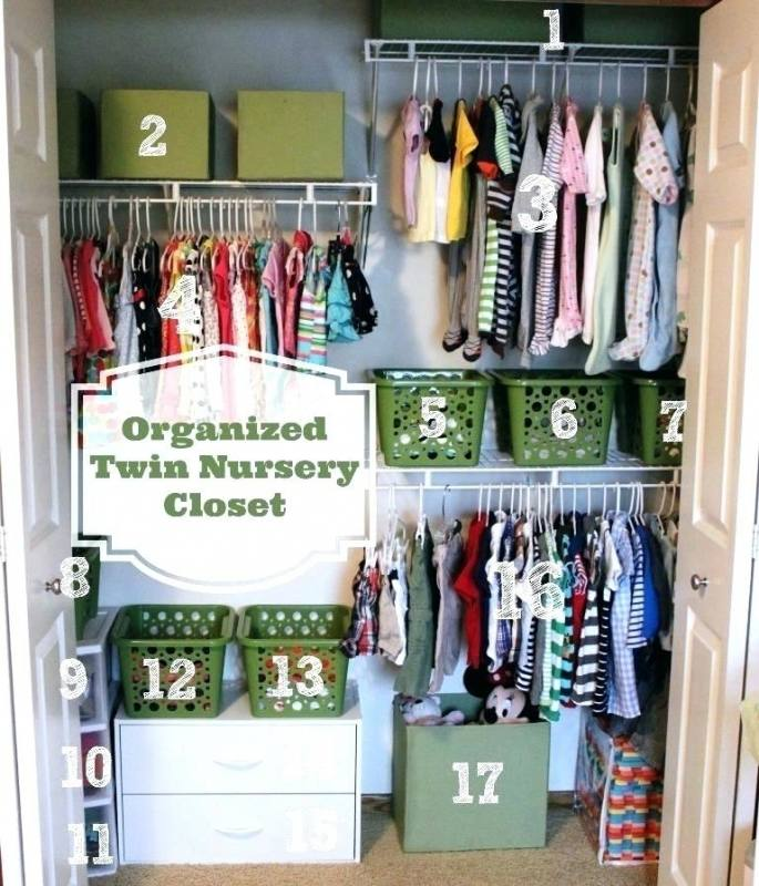 white wooden closet with stainless cloth hooks and drawers also racks connected by grey