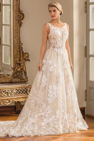 Back of Flattering fit with soft and romantic lace modest wedding gown, style Woodbury,