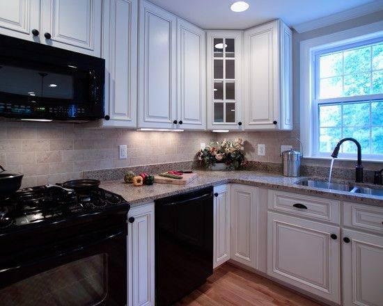how to decorate a kitchen with black appliances and white cabinets