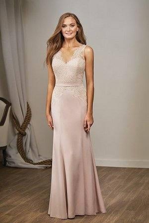 A woman tries on a wedding dress at a bridal fashion trade show