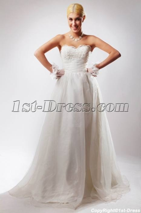 Ivory wedding dress crafted in stretch silk and embroidered lace Mermaid wedding  gown without sleeves and open back Top features sweetheart cleavage and