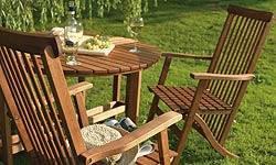 A comfortable, deep seated hardwood garden sofa set