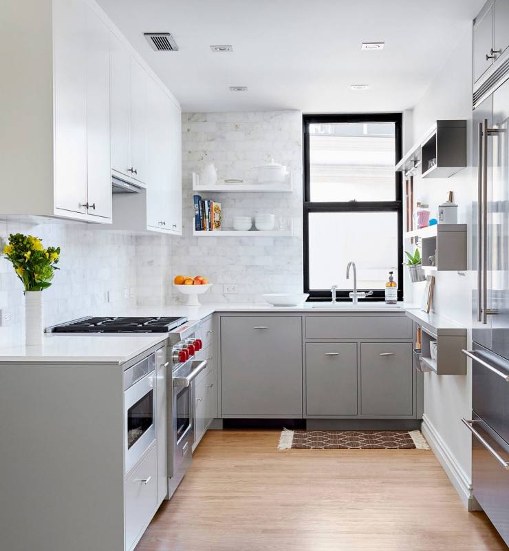 Gray tiles shape a lovely background in the small kitchen [Design:  CliqStudios Cabinets]