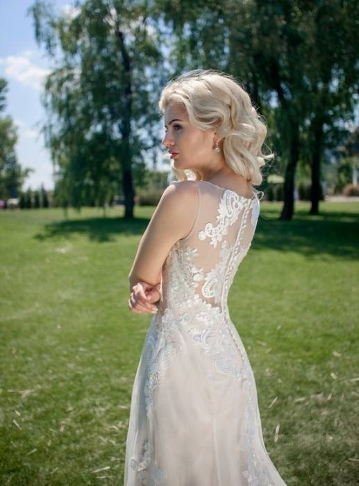 A simple ivory wedding dress is very classy without the added accents