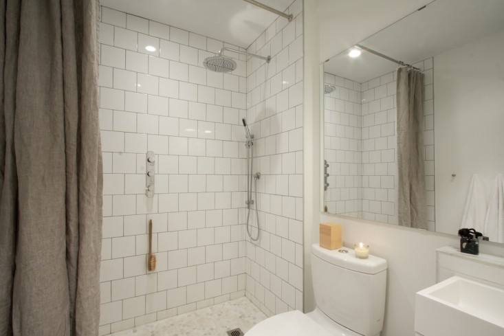 sfgirlbybay Clé tiles' zellige white weathered hex in shower with wood table