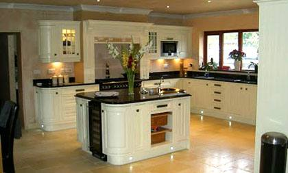 Skimming Stone from Farrow and Ball matches the gorgeous pale Aga in this  Shaker kitchen from www