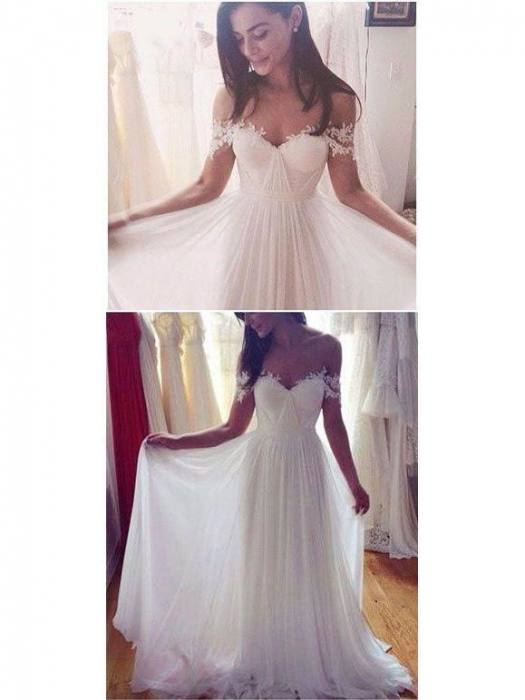 statement back wedding dress with lace cutout and cap sleeves and long,  full skirt