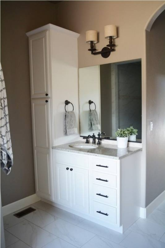 bathroom linen cabinet and vanity