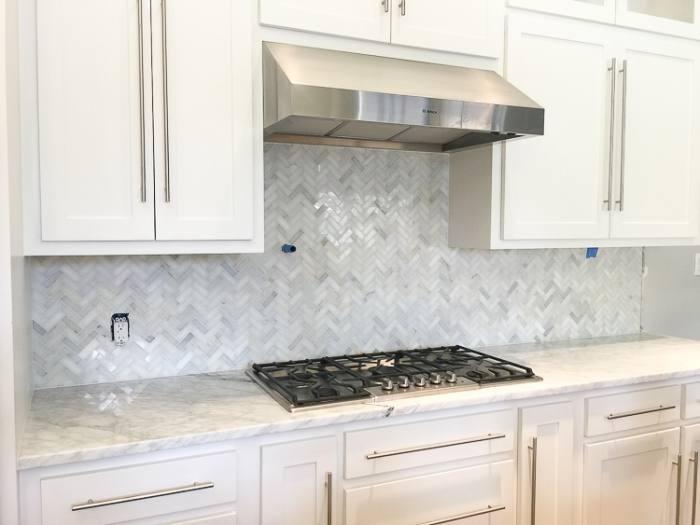 Here's another backsplash with the switch plates painted and not the electrical outlets