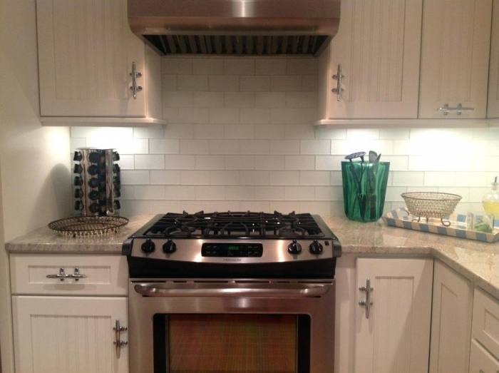The beautiful blue backsplash tiles are from Heath Ceramics