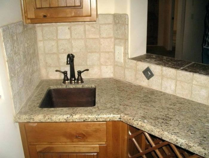 Consider a brick Travertine backsplash design