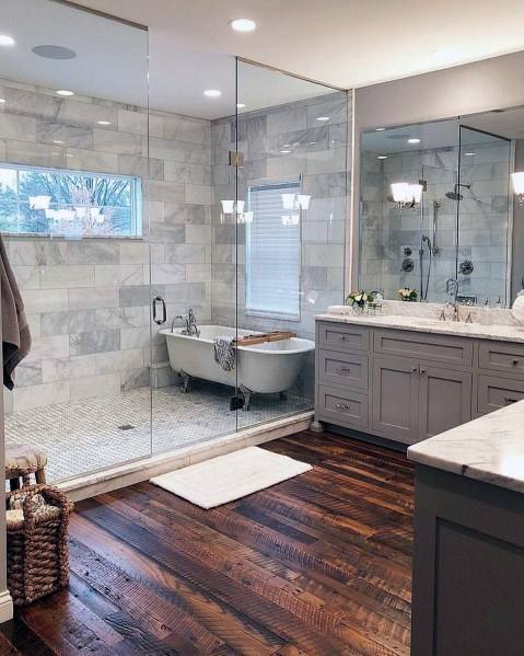 This bathroom features extravagant tile work and an extremely spacious  floor plan
