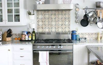 Extend your stylish subway tile backsplash across your kitchen walls to  create a elegant vibe