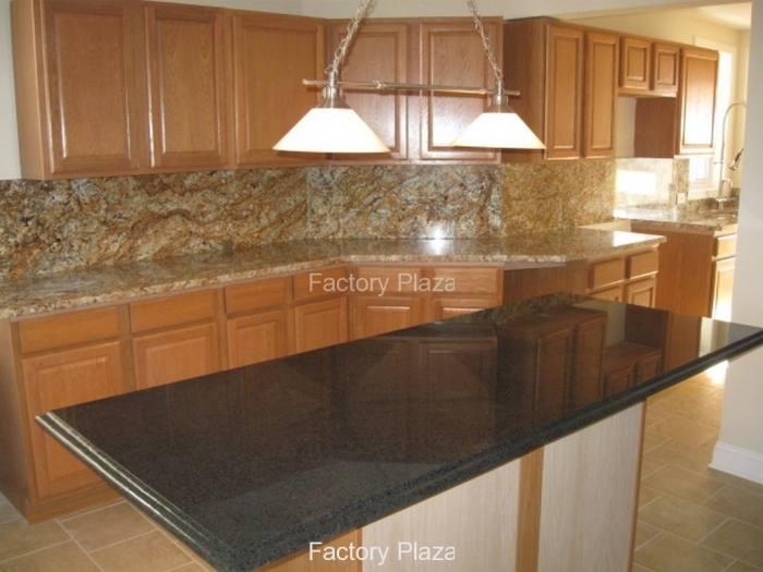 Natural cherry cabinets, travertine tile backsplash, black granite  countertop, stainless steel range hood and pot filller