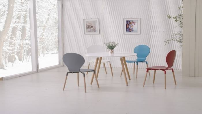 These dining rooms mix styles as well, the first has traditionally styled  velour chairs with a contemporary table