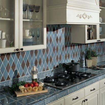 This backsplash shows how contrasting patterns and materials can create a  beautiful focal point