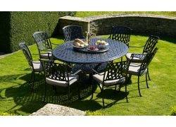 Naples round table (100cm) and four Etna armchairs with seat cushions