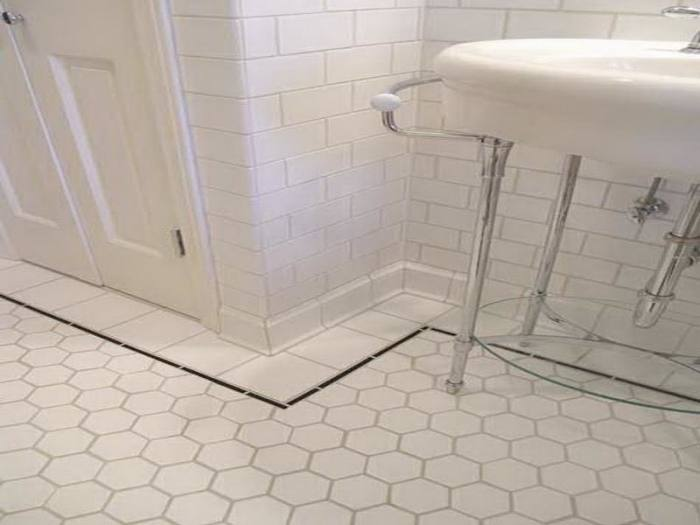 The ideal is a tile that has a slightly varied tone that gives just a hint  of natural texture to create a soft, subdued look