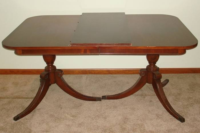 Traditional oval mahogany dining room table