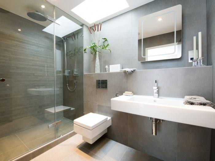 This traditional style bathroom has the feel of extra space by use of  oversized amenities