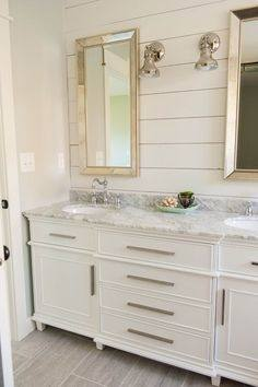Gorgeous+master+bathroom+features+a+light+grey+double+vanity+adorned+with+polished+nickel+knobs+