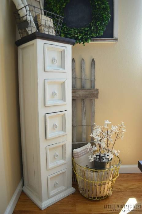 Wooden corner accent cabinet has an English walnut finish